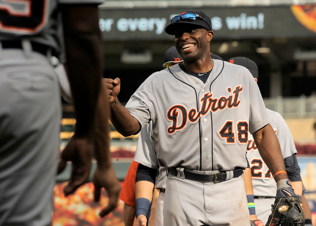 . Detroit Tigers� Torii Hunter (48) celebrates a 13-4 win over the Minnesota Twins in a baseball game in Minneapolis, Sunday, Aug. 24, 2014. (AP Photo/Tom Olmscheid)