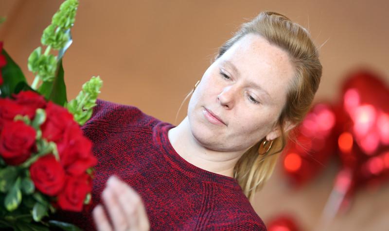 Rebecca Parks straightens a flower arrangement at Mrs. DeHaven's Flower Shop in downtown Tulsa.