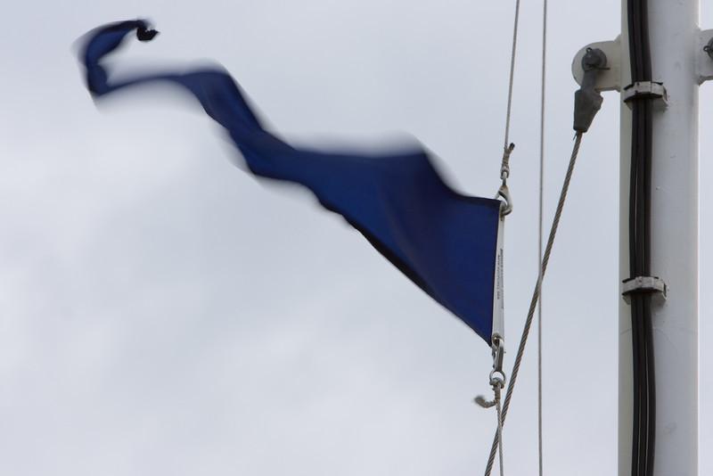 Flag flying on the forward mast.