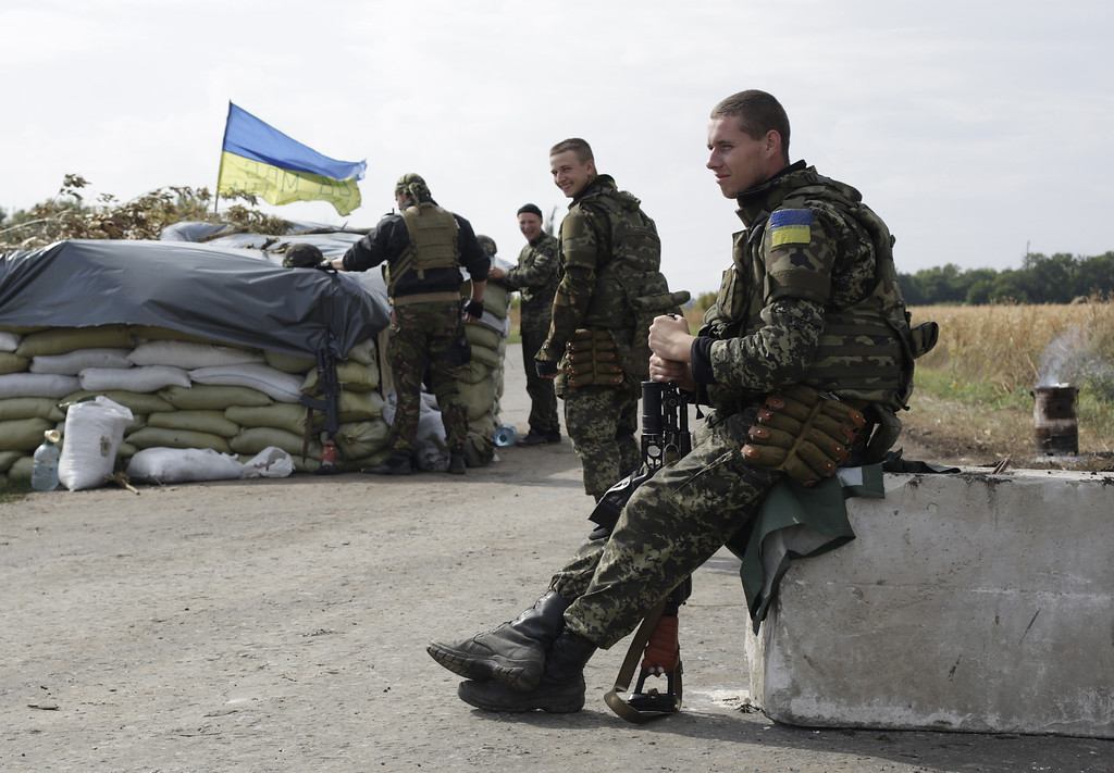 . Ukrainian soldiers guard at a checkpoint controlled by Ukrainian forces on September 10, 2014, near the small eastern Ukrainian city of Slavyanoserbsk, in the Lugansk region. AFP PHOTO/ ANATOLII STEPANOVANATOLII STEPANOV/AFP/Getty Images