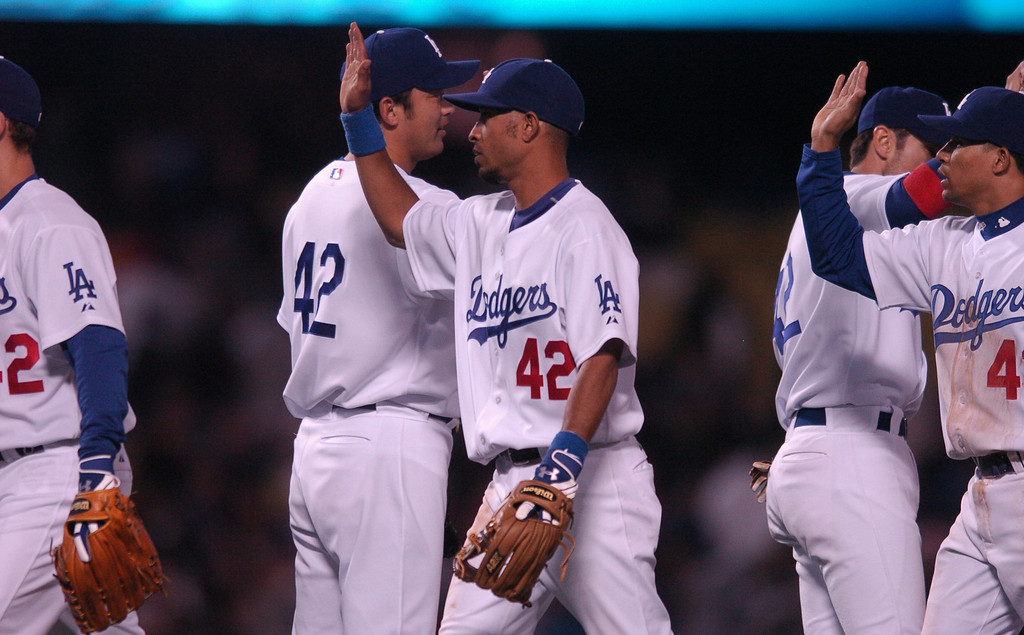 . The Dodgers\' Wilson Valdez, center, congratulates teammates after beating  the San Diego Padres 9-3 at Dodger Stadium during Jackie Robinson Day, Sunday April 15, 2007. (Michael Owen Baker/Los Angeles Daily News)