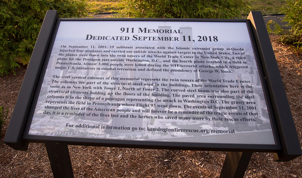 09/11/19 Wesley Bunnell | StaffrrThe Kensington Fire Department held a 9/11 memorial service on Wednesday evening in front of the department at 880 Farmington Ave. A plaque describing the 9/11 memorial structures in front of the fire station.