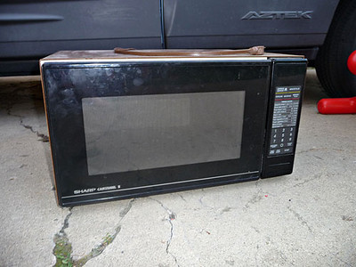 Sharp microwave.  Works, but carousel plate is chipped.  $5