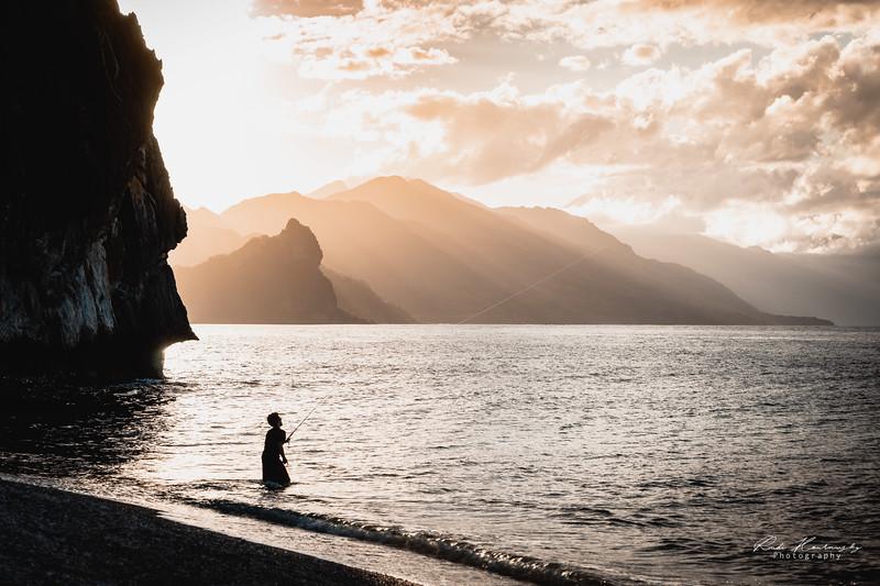 Fishing man  at sunset
