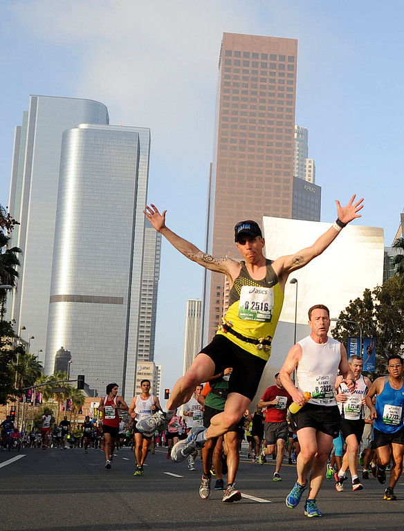 . Competitors make their way along Grand Ave in Los Angeles during the Los Angeles Marathon Sunday, March 17, 2013. (Hans Gutknecht/Staff Photographer)