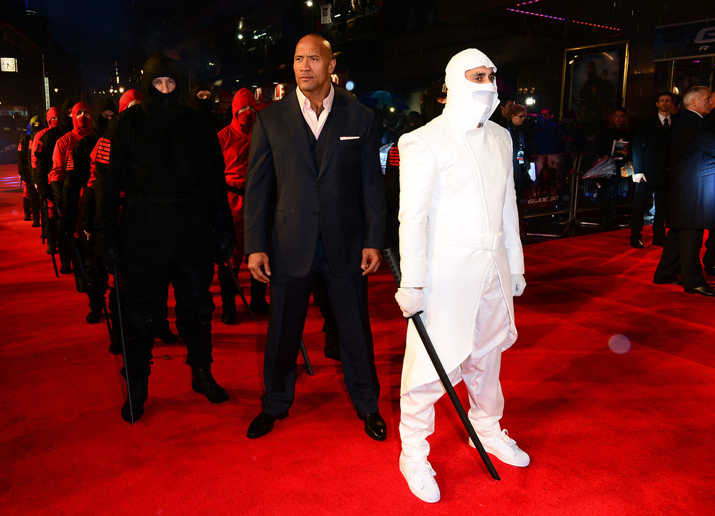 """. Dwayne Johnson arrives at the British premiere of \""""G.I. Joe: Retaliation\"""" at a cinema in Leicester Square, London, Monday, March 18, 2013. (Photo by Jon Furniss/Invision/AP)"""