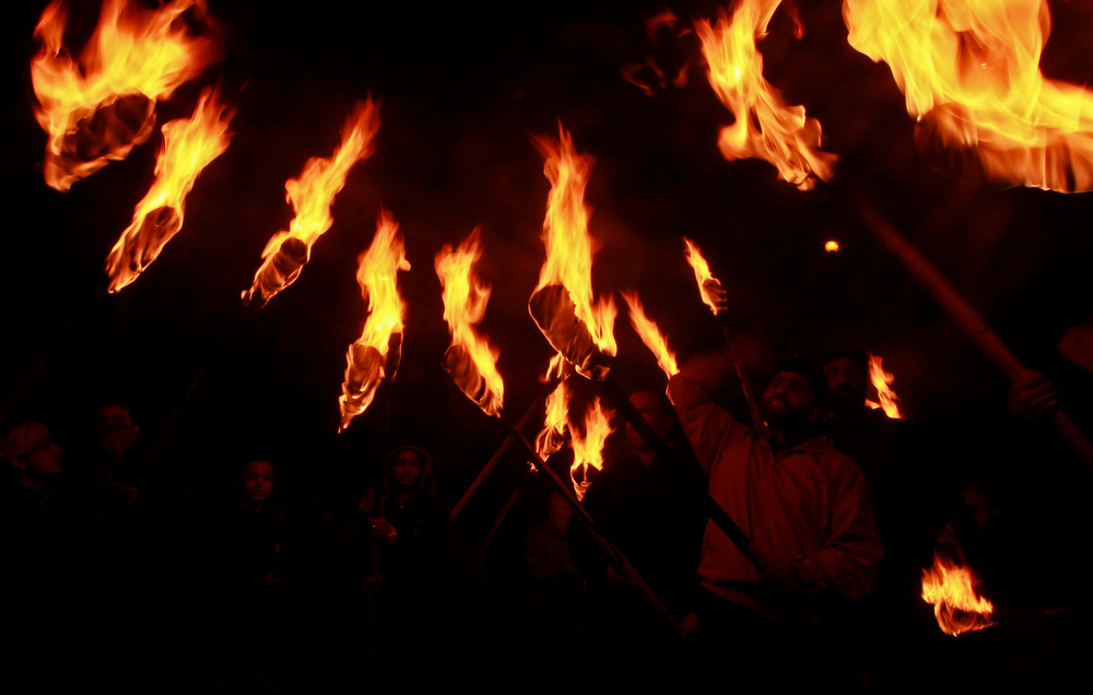 Description of . Activists of the Kashmiri separatist party, the Jammu Kashmir Liberation Front (JKLF), shout slogans while holding torches during a procession to mark the International Human Rights Day in Srinagar December 10, 2012. The procession was held to protest against what the JKLF say are human rights violations by the Indian security forces on Kashmiris. JKLF, which declared a ceasefire in 1994 against Indian security forces, says it leads a political struggle for Kashmir's complete independence from both India and Pakistan, who claim the region in full but rule in parts. REUTERS/Fayaz Kabli