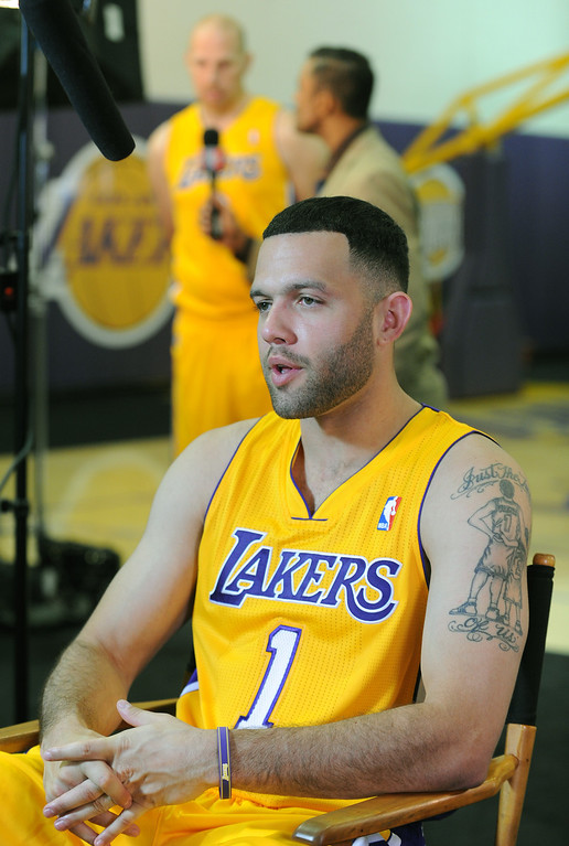 . Jordan Farmar is interviewed. The Los Angeles Lakers held a media day at their El Segundo practice facility. Players were photographed for team materials, and interviewed by the press. El Segundo, CA. 9/27/2013. photo by (John McCoy/Los An8eles Daily News)
