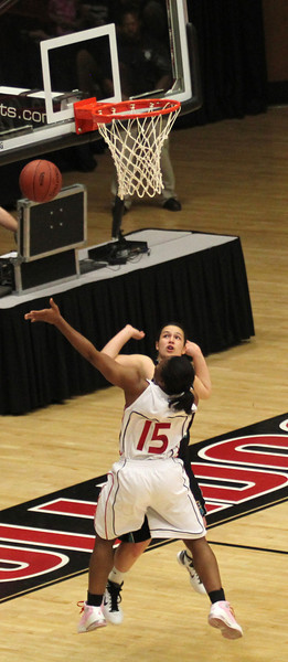 Monique Hudson (15) goes for a layup in her game against the Chanticleers.