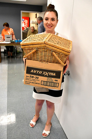 8/7/2019 Mike Orazzi | Staff Erica during the Plainville Senior Center tag sale on Wednesday.