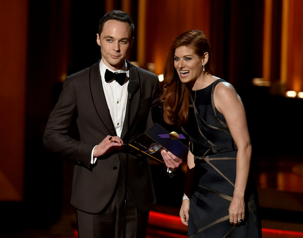 . Actors Jim Parsons (L) and Debra Messing speak onstage at the 66th Annual Primetime Emmy Awards held at Nokia Theatre L.A. Live on August 25, 2014 in Los Angeles, California.  (Photo by Kevin Winter/Getty Images)
