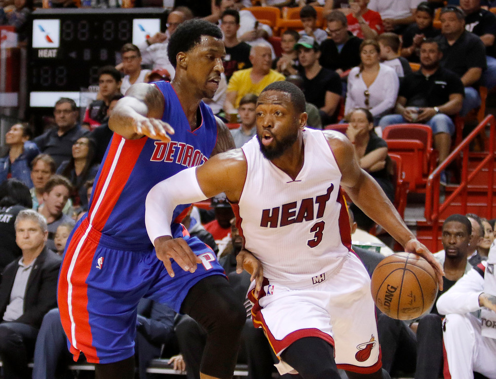 . Miami Heat guard Dwyane Wade (3) drives past Detroit Pistons guard Kentavious Caldwell-Pope trails during the first half of an NBA basketball game, Sunday, March 29, 2015, in Miami. (AP Photo/Joe Skipper)