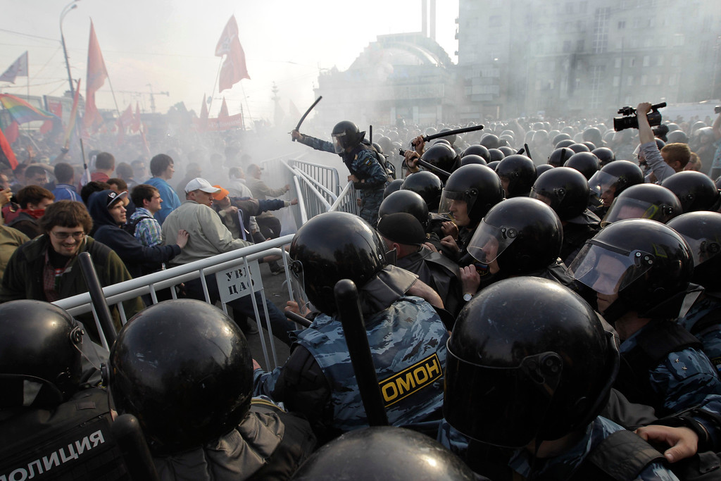 . In this May 6, 2012 file photo, Russian riot police disperse opposition protesters in downtown Moscow. Riot police in began arresting protesters who were trying to reach the Kremlin in a demonstration on the eve of Vladimir Putin\'s inauguration as president. (AP Photo/Sergey Ponomarev, File)