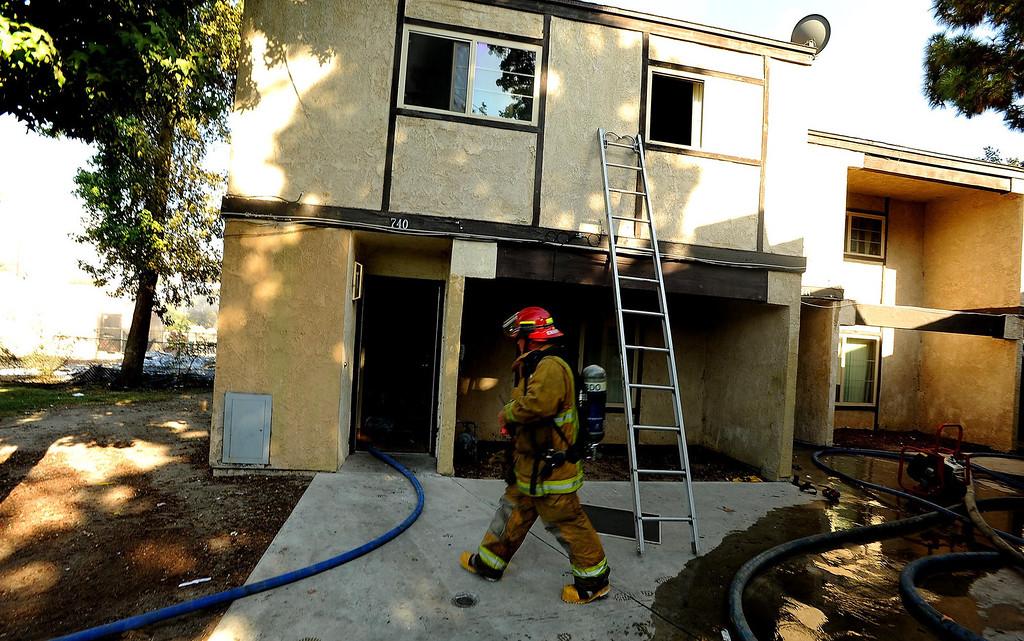. A scene from a four-alarm fire along the 700 block of Seventh Street in San Bernardino August 18, 2013. GABRIEL LUIS ACOSTA/STAFF PHOTOGRAPHER.