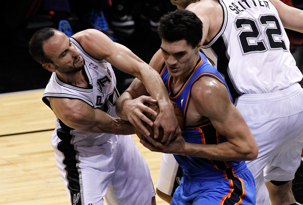 . Manu Ginobili #20 of the San Antonio Spurs and Steven Adams #12 of the Oklahoma City Thunder battle for the ball in the first half in Game Two of the Western Conference Finals during the 2014 NBA Playoffs at AT&T Center on May 21, 2014 in San Antonio, Texas.   (Photo by Chris Covatta/Getty Images)