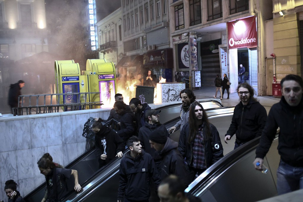 . Protesters take the underground to escape police in Athens on December 6, 2014 as youths commemorate the sixth anniversary of the fatal shooting of teenager Alexis Grigoropoulos by a police officer, an event that plunged Greece into weeks of youth riots. AFP PHOTO / ANGELOS  TZORTZINIS/AFP/Getty Images
