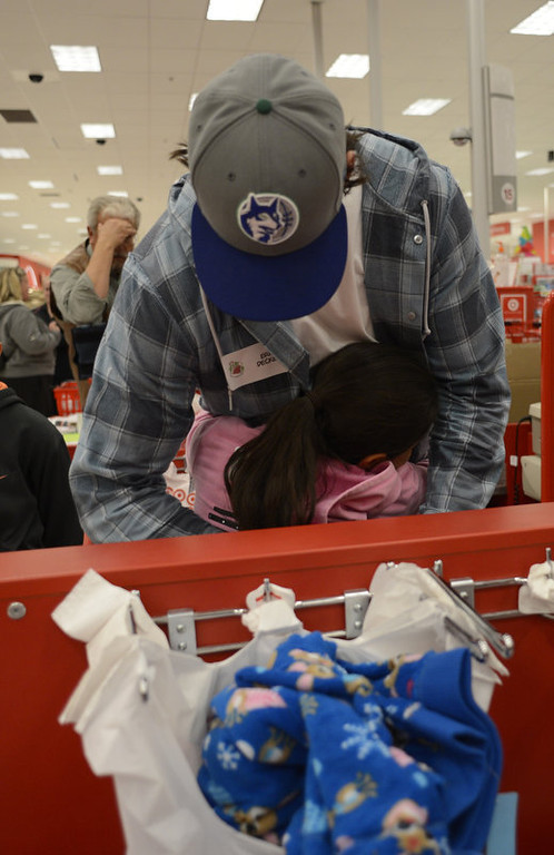 . Broncos wide receivers Eric Decker gets a big hug from Ashley after checking out at the register at Target. Eric Decker and Demaryius Thomas along with other teammates reached out to help children in their community by hosting a holiday shopping trip at Super Target Tuesday, December 11, 2012 in Lone Tree. 25 children, ranging in age from 8 to 14, are being rewarded for their outstanding participation in their after-school program with a trip to buy holiday presents. John Leyba, The Denver Post