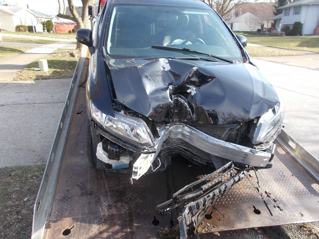 . Courtesy of Willoughby Police Department <br> According to the Willoughby Police Department\'s Facebook page, a 23-year-old driver went off the right side of Oakridge Drive and struck a tree after looking down at her cell phone.
