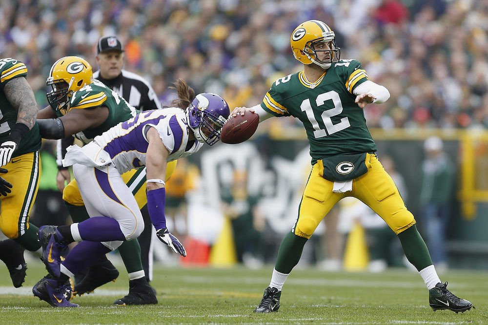 . Aaron Rodgers #12 of the Green Bay Packers throws a pass against the Minnesota Vikings at Lambeau Field on December 2, 2012 in Green Bay, Wisconsin.  The Packers defeated the Vikings 23-14.  (Photo by Wesley Hitt/Getty Images)