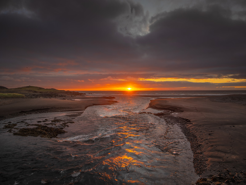 Flowing to the Sun in Iceland   Photography by Wayne Heim