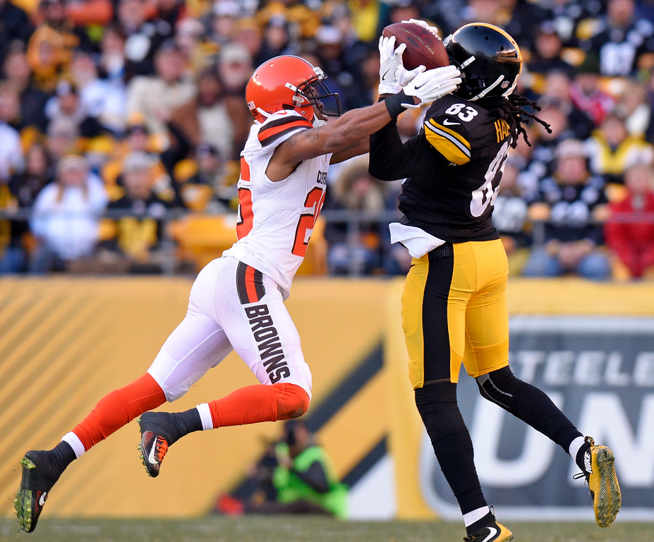 . Pittsburgh Steelers wide receiver Cobi Hamilton (83) catches a pass with Cleveland Browns defensive back Marcus Burley (26) defending during the second half of an NFL football game in Pittsburgh, Sunday, Jan. 1, 2017. (AP Photo/Don Wright)
