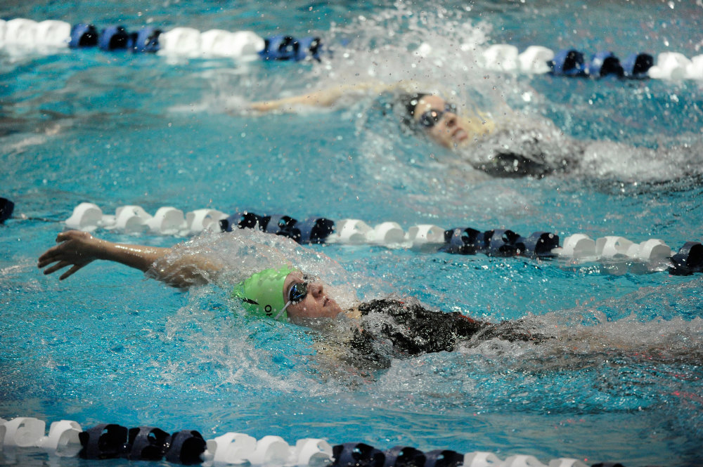 . Fossil Ridge High School sophomore Bailey Nero, bottom, chased Mountain Range High School sophomore Shelly Drozda, top, during the 200-yard Individual Medley race. The Colorado Coaches Invitational Swimming and Diving Meet wrapped up Saturday night, December 15, 2012.  Karl Gehring/The Denver Post