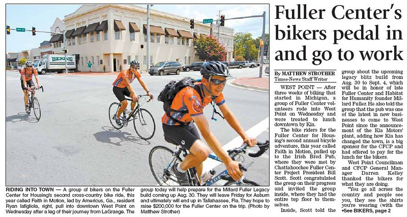 09 08-05 Bikers ride into West Point, AL. Ryan Iafigliola, leader of Bike Adventure, is in the lead. The bikers will spend the night and work in the warehouse helping to prepare for the Millard Fuller Legacy Build that kick-off the end of August. Photo compliments of Valley Times-News.