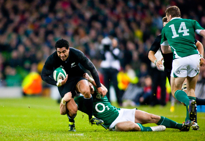 Mils Muliana is tackled during the International rugby test with Ireland against the New Zealand All Blacks at Aviva Stadium Dublin. November 2010