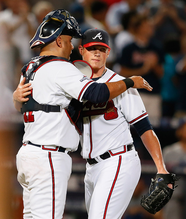 . ATLANTA, GA - OCTOBER 04: Gerald Laird #11 and Craig Kimbrel #46 of the Atlanta Braves hug after defeating the Los Angeles Dodgers during Game Two of the National League Division Series at Turner Field on October 4, 2013 in Atlanta, Georgia.  (Photo by Kevin C. Cox/Getty Images)