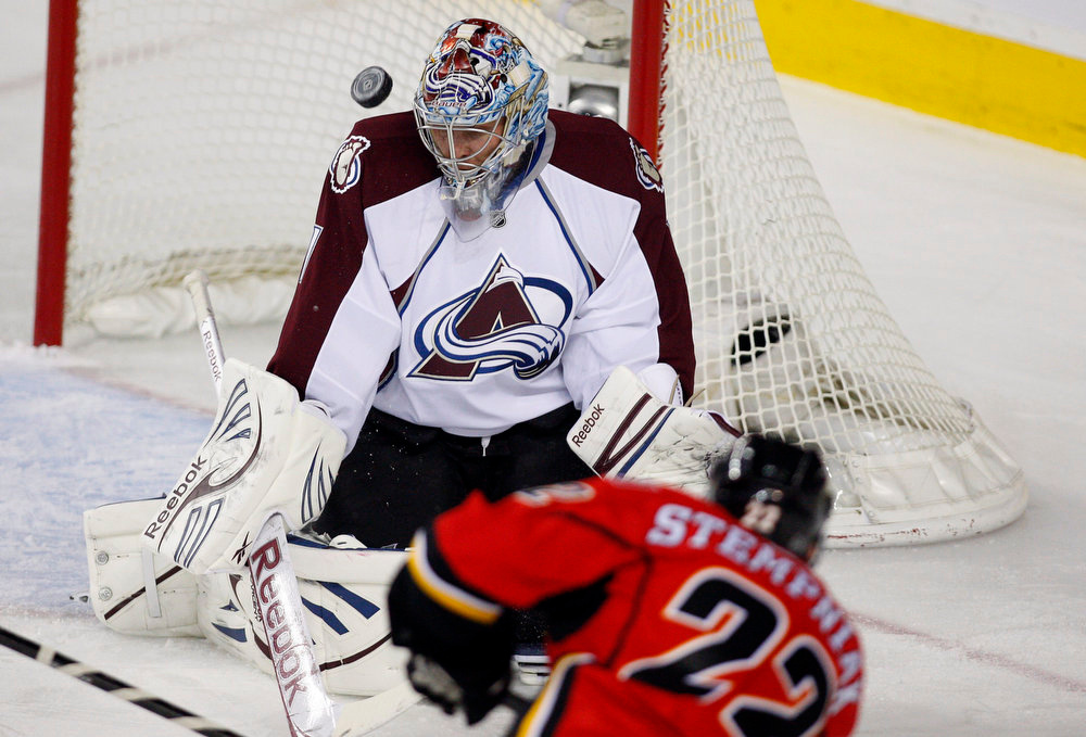 . Colorado Avalanche goalie Semyon Varlamov, left, of Russia, stops a shot from Calgary Flames\' Lee Stempniak during the first period of their NHL hockey game in Calgary, Alberta, Wednesday, March 27, 2013. (AP Photo/The Canadian Press, Jeff McIntosh)