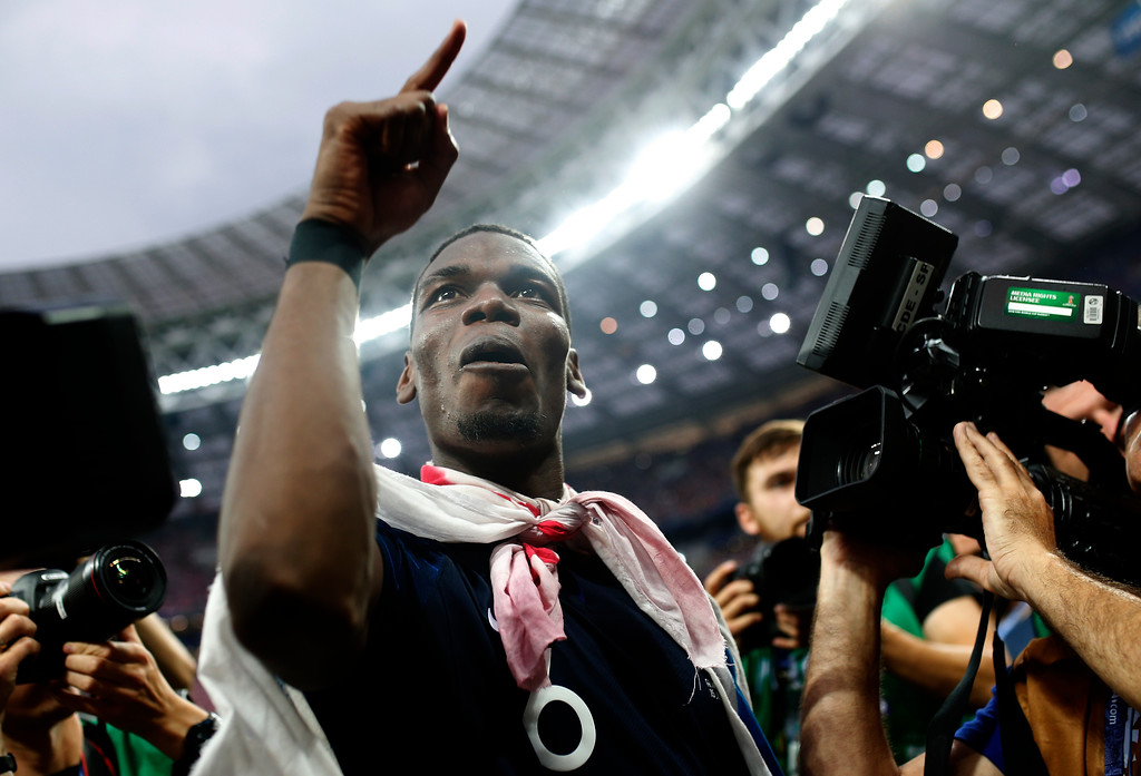 . France\'s Paul Pogba gestures to the fans after France defeated Croatia in the final match between France and Croatia at the 2018 soccer World Cup in the Luzhniki Stadium in Moscow, Russia, Sunday, July 15, 2018. France won the game 4-2. (AP Photo/Francisco Seco)