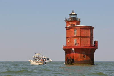 People fish around Wolf Trap Lighthouse, in the Chesapeake Bay of Virginia. © 2020 Kenneth R. Sheide
