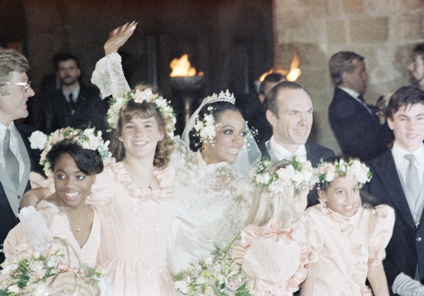 . American singer Diana Ross is shown with her new husband Arne Naess, Jr. on their wedding day, Oct. 23, 1985, in Geneva, Switzerland. (AP Photo/Michel Euler)