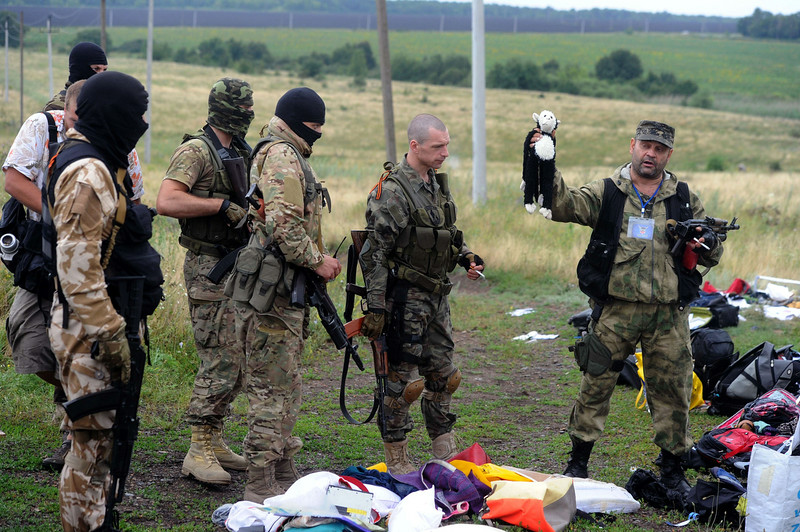 . A pro-Russia militant holds up a stuffed animal as others look on at the site of the crash of a Malaysian airliner carrying 298 people from Amsterdam to Kuala Lumpur in Grabove, in rebel-held east Ukraine, on July 18, 2014. Pro-Russian separatists in the region and officials in Kiev blamed each other for the crash, after the plane was apparently hit by a surface-to-air missile. Members of the UN Security Council demanded a full, independent investigation into the apparent shooting down of a Malaysia Airlines jet over Ukraine. (DOMINIQUE FAGET/AFP/Getty Images)
