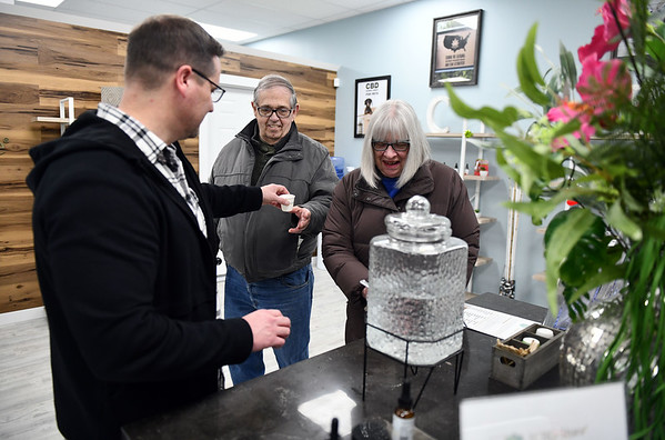 12/5/2019 Mike Orazzi | StaffrYour CBD Store Manager Jeremy Morgan passes out samples of CBD oil to Linda and James Konopaske at the Bristol location.