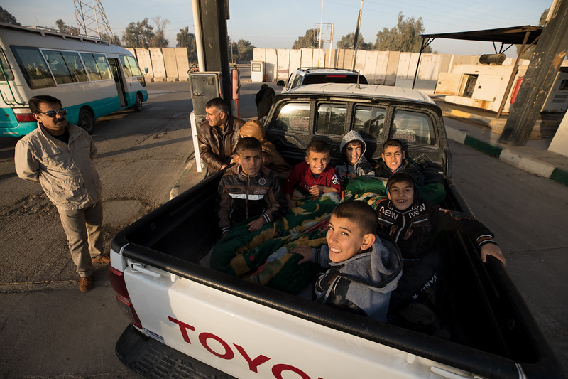Boys in the back of pickup at a service station, north of Baghdad.