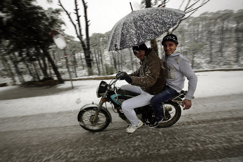 . A man rides his motorbike as snow falls in the village of Nabeh al-Safa, Lebanon on January 8, 2013. Stormy weather, including high winds and heavy rainfall, lashed the eastern Mediterranean coast, downing power lines and trees and causing several injuries in a number of countries. JOSEPH EID/AFP/Getty Images
