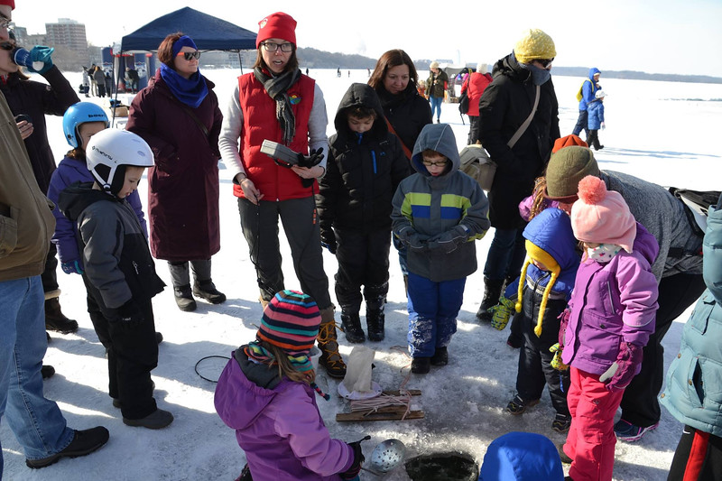 CFL Grad Student, Samantha Oliver exploring the world under the ice with future scientists at the ice science lab.