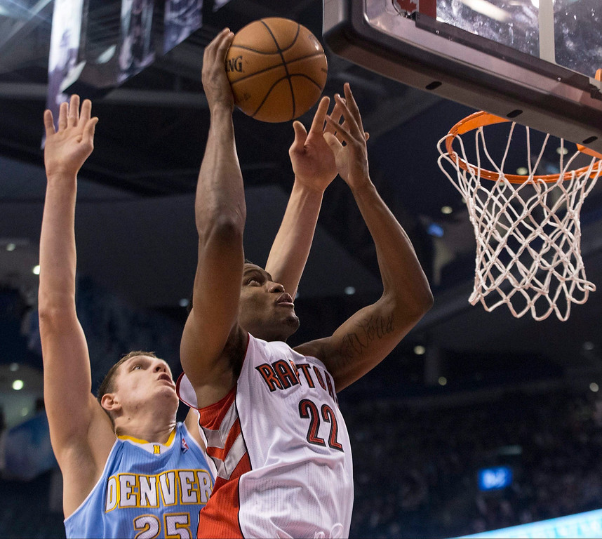 . Toronto Raptors\' Rudy Gay, right, scores as Denver Nuggets\' Timofey Mozgov defends during the first half of an NBA basketball game on Sunday, Dec. 1, 2013, in Toronto. (AP Photo/The Canadian Press, Chris Young)