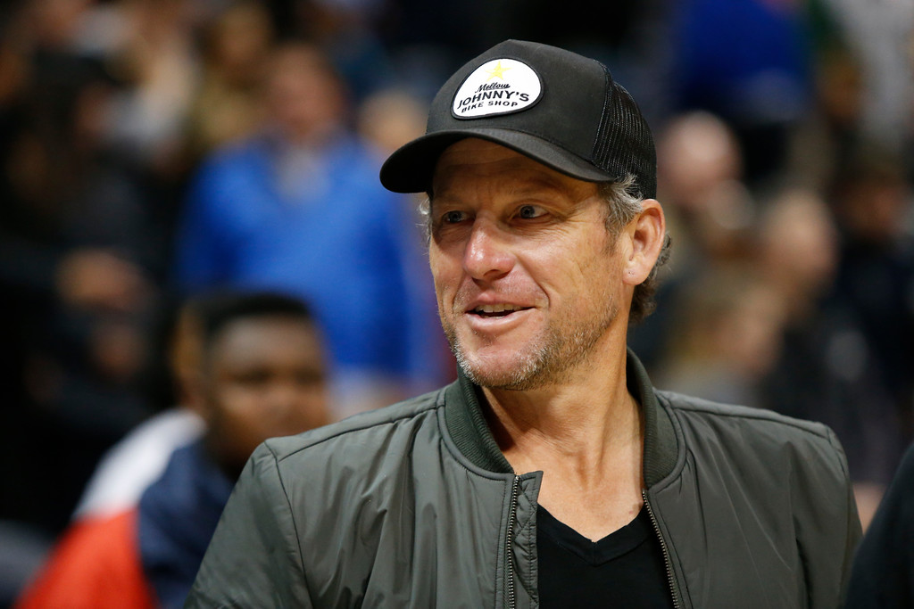 . Former cyclist Lance Armstrong on the court after an NBA basketball game between the Cleveland Cavaliers and Atlanta Hawks, Friday, March 3, 2017, in Atlanta. The Cavaliers won 135-130. (AP Photo/Brett Davis)