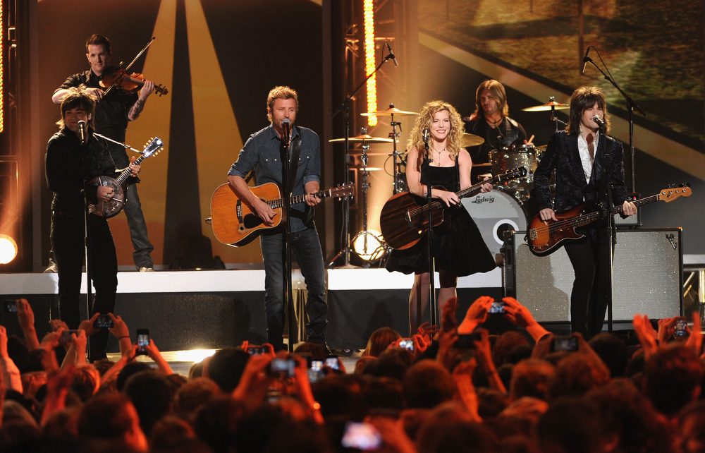 Description of . Musician Neil Perry of The Band Perry, singer Dierks Bentley and Kimberly Perry and Reid Perry of The Band Perry perform onstage at The GRAMMY Nominations Concert Live!! held at Bridgestone Arena on December 5, 2012 in Nashville, Tennessee.  (Photo by Kevin Winter/Getty Images)