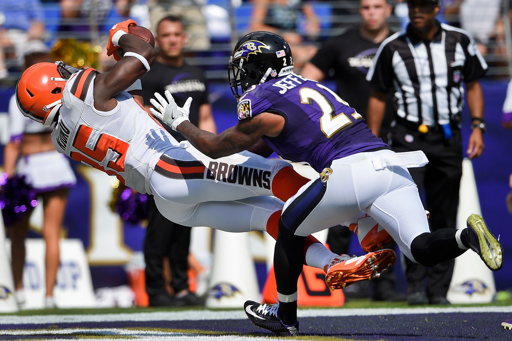 . Cleveland Browns tight end David Njoku (85) pulls in a touchdown pass under pressure from Baltimore Ravens strong safety Tony Jefferson (23) during the first half of an NFL football game in Baltimore, Sunday, Sept. 17, 2017. (AP Photo/Nick Wass)