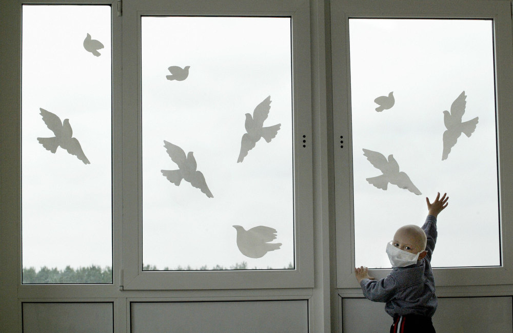 . Belarus Vladislav Petrov, 3.5-year-old, patient in the hematological department of radiology and nuclear medicine institute in Gomel, plays with paper pigeons 06 September 2005. Some 4,000 people may eventually die from radiation exposure as a result of the 1986 Chernobyl nuclear power plant disaster, but this toll is much lower than feared, according to a panel of UN experts. VIKTOR DRACHEV/AFP/Getty Images