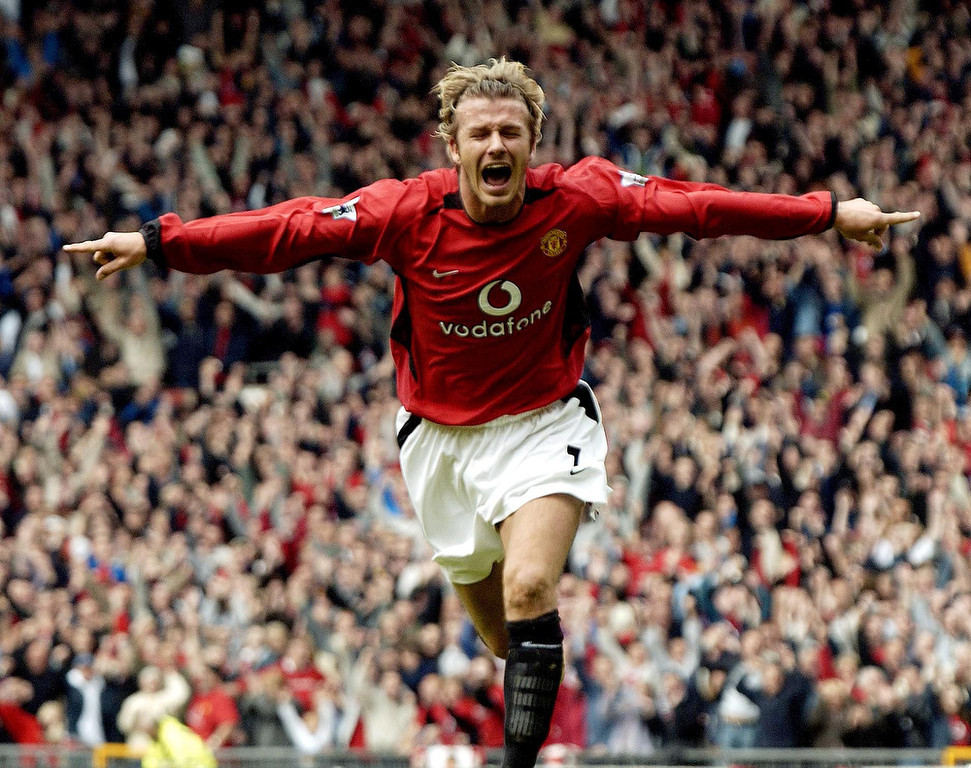 . In a file picture taken on May 3, 2003 David Beckham celebrates after making it Manchester United 1-Charlton 0 during their English Premier League football match at Old Trafford, in Manchester.  PAUL BARKER/AFP/Getty Images