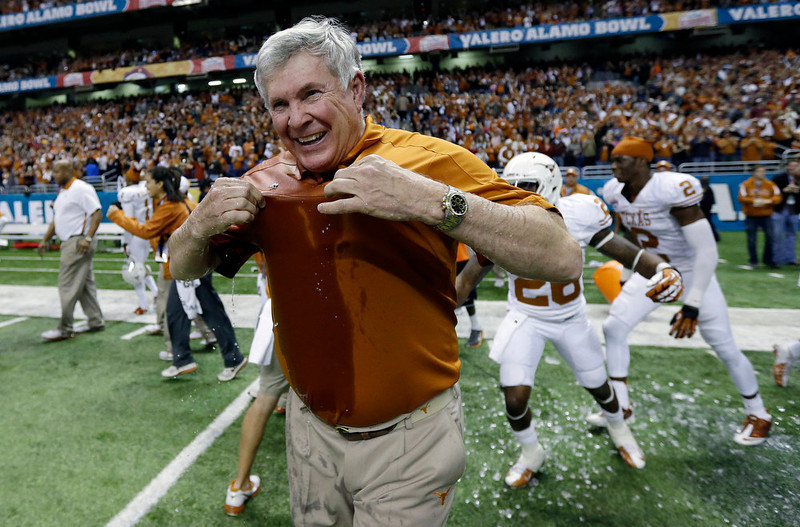 . Texas head coach Mack Brown reacts after he was doused following the Longhorns win over Oregon State in the Alamo Bowl NCAA football game, Saturday, Dec. 29, 2012, in San Antonio.  Texas won 31-27. (AP Photo/Eric Gay)
