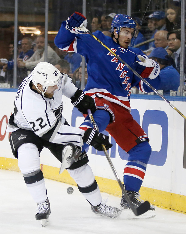 . Los Angeles Kings center Trevor Lewis (22) vies for the puck against New York Rangers defenseman Ryan McDonagh (27) in the first period during Game 3 of the NHL hockey Stanley Cup Final, Monday, June 9, 2014, in New York. (AP Photo/Kathy Willens)