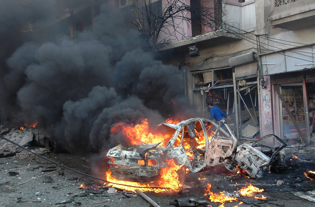 . Flames engulf a vehicle following a car bomb along  al-Khudary Street in the Karm al-Loz neighborhood in the city of Homs on April 9, 2014. More than 150,000 people have been killed in Syria since the conflict began in March 2011, a monitoring group said in a new toll released. (AFP/Getty Images)