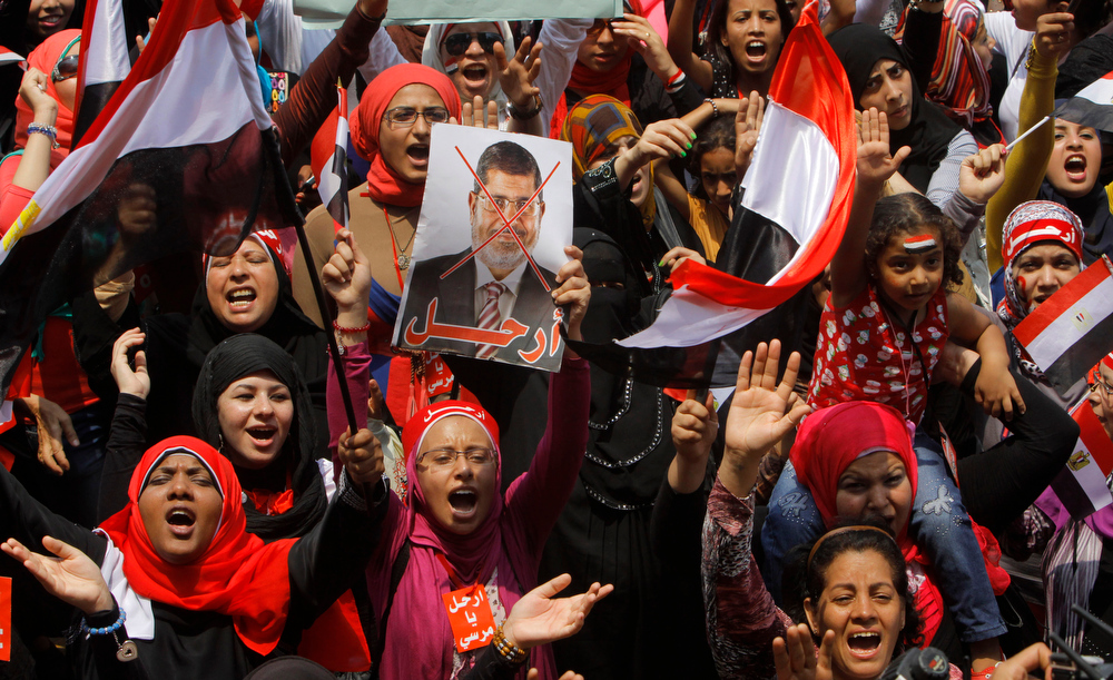". Opponents of Egypt\'s Islamist President Mohammed Morsi shout slogans during a protest in Tahrir Square in Cairo, Egypt, Wednesday, July 3, 2013. Arabic read "" leave.\""  Egypt\'s leading democracy advocate Mohamed ElBaradei and top Muslim and Coptic Christian clerics met Wednesday with the army chief to discuss a political road map for Egypt only hours before a military ultimatum to the Islamist president was set to expire.(AP Photo/Amr Nabil)"