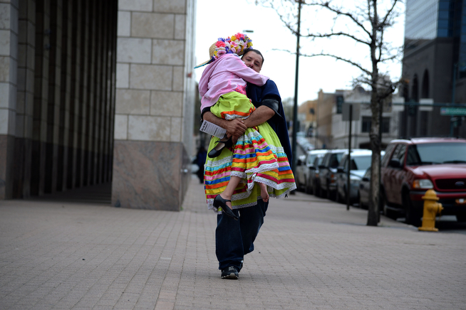 . Ralph Andrade carries his daughter Natasha, 10, before her performance at the McNichols Building. The Día del Niño celebration of culture on Sunday, April 27, 2014. (Photo By AAron Ontiveroz/ The Denver Post)