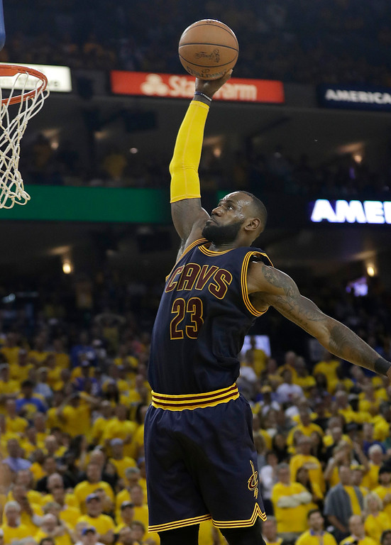 . Cleveland Cavaliers forward LeBron James (23) dunks against the Golden State Warriors during the second half of Game 1 of basketball\'s NBA Finals in Oakland, Calif., Thursday, June 1, 2017. (AP Photo/Marcio Jose Sanchez)